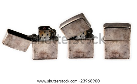 Three old brass cigarette lighters isolated on white