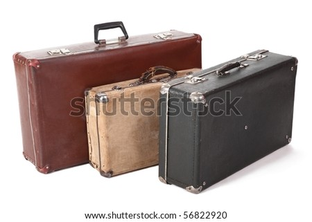 three old dirty dusty suitcase. focus on front corner of yellow suitcase. isolated - stock photo