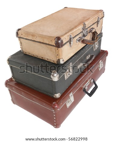 three old dirty dusty suitcases. all suitcases is closed. Isolated. focus on front corner of black suitcase.