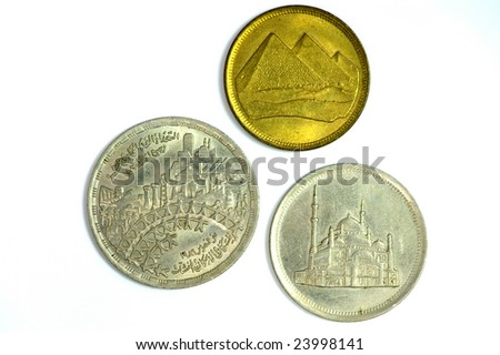 Three old Egyptian coins isolated on white - stock photo