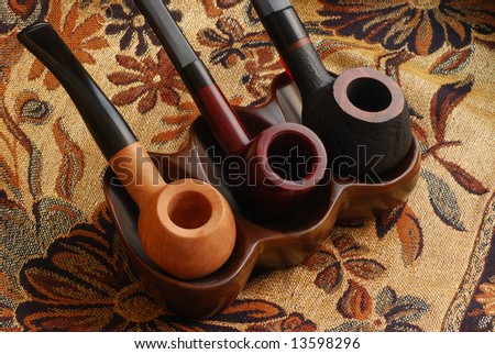 three old hand carved tobacco pipes