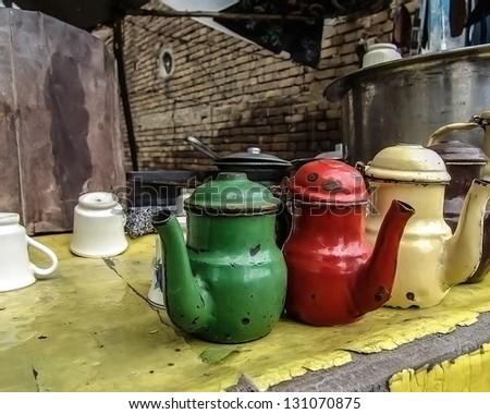 three old kettles in roadside tea shop - stock photo