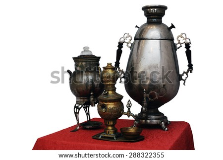 three old Russian samovar, traditional kettle, on a white background - stock photo