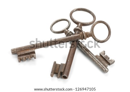 Three old skeleton keys, isolated on white with soft shadows. Clipping path included. - stock photo