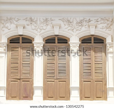 three old window on classic wall - stock photo