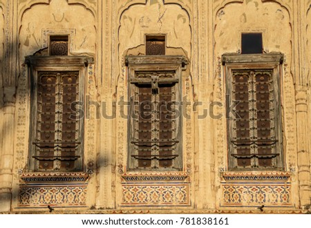 Three old windows with shutters