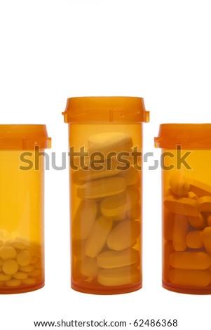 Three open prescription bottles - stock photo