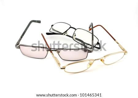 Three optical glasses over white - stock photo