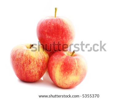 three or four apples on a white background - support concept - stock photo