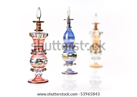 Three oriental perfume bottles, isolated on white, perspective view.