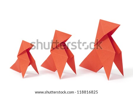 Three origami birds on white background. Concept of growth. - stock photo