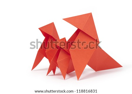 Three origami birds on white background. Concept of safety under parental protection. - stock photo