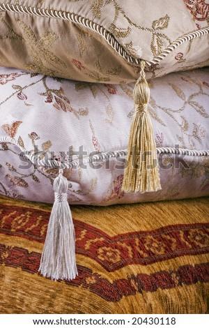 Three ornate cushions, home furnishing background texture - stock photo