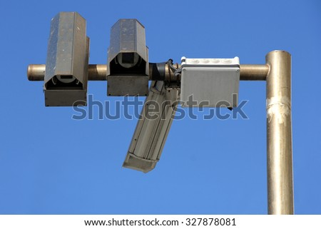 Three outside security cameras, blue sky backgraund - stock photo