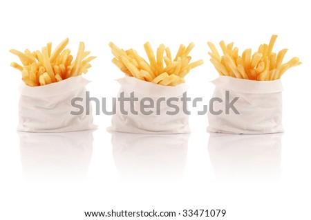 Three packs of french fries - stock photo