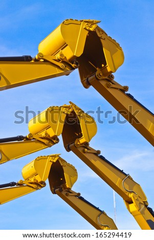 three pairs of excavator buckets joining together - stock photo
