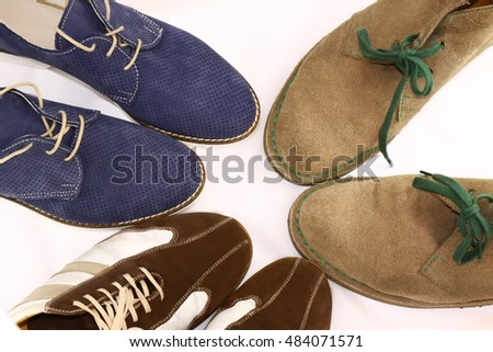 three pairs of man shoes