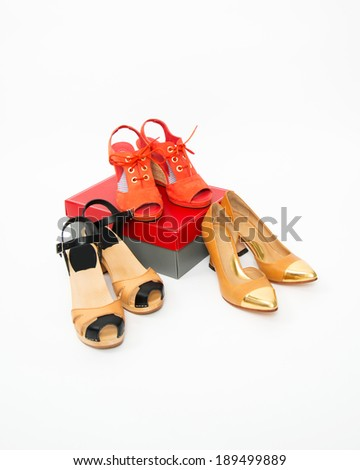 Three Pairs of New Fashionable Shoes on White Background