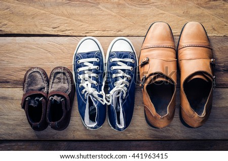 Three pairs of shoes, three stages of the growth.
