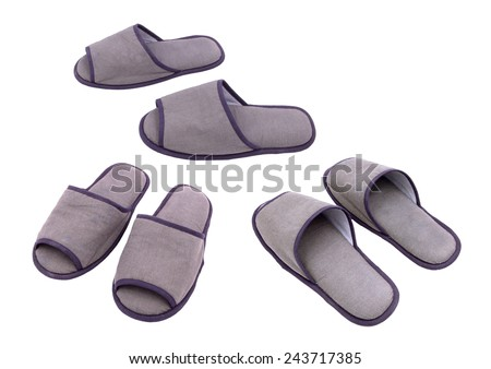Three pairs of slippers isolated against white background - stock photo