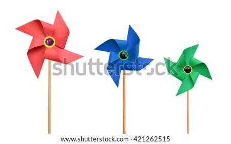 Three Paper pinwheels isolated on white background - stock photo