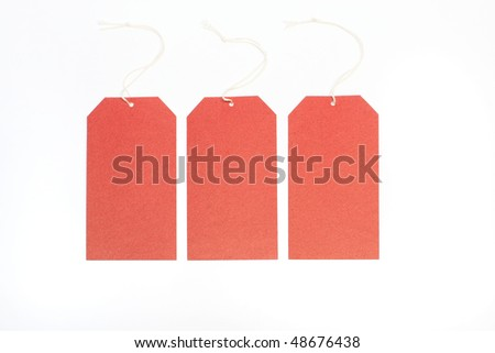 Three paper red labels on a white background.