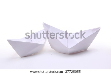 Three paper ships isolated on white