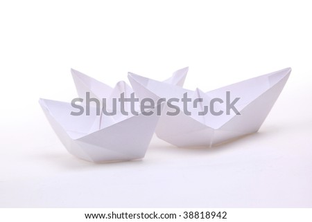 Three paper ships isolated on white - stock photo
