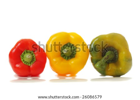 Three paprika sideviews of different colors photo with reflections