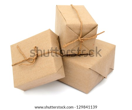 three parcels boxes with kraft paper, isolated white background