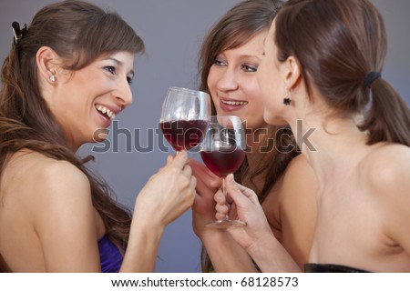 three party girls celebrating over grey background