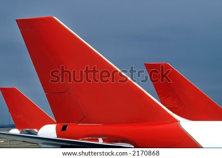 Three passenger aircraft tails, forming interesting pattern - stock photo