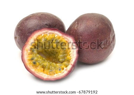 Three passion fruit one sliced - stock photo