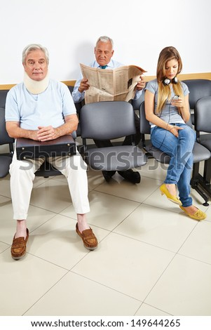 Three patients waiting in a waiting room of a hospital - stock photo