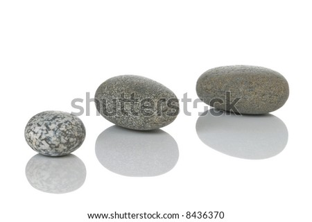 Three pebbles with reflections, isolated on white.