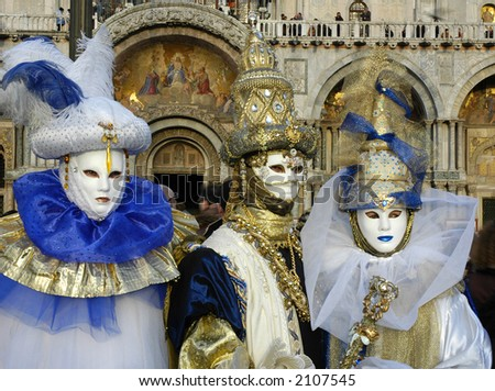 Three people are dressed for the Carnivale in Venice,Italy - stock photo