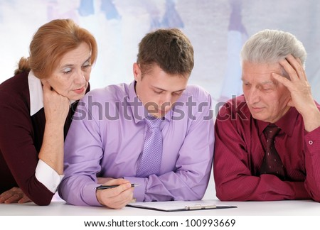 Three people are sitting on a light - stock photo
