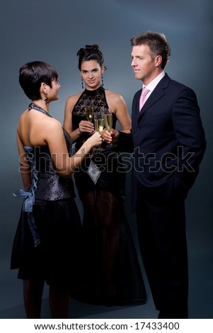 Three people drinking champagne on a party. - stock photo