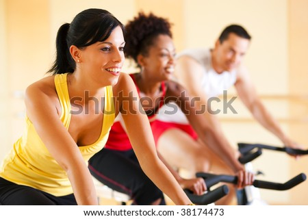 Three people in the gym - stock photo