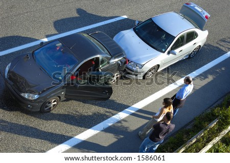 Three people stand by the roadside after a small shunt on the freeway (motorway, autoroute, autobahn). - stock photo