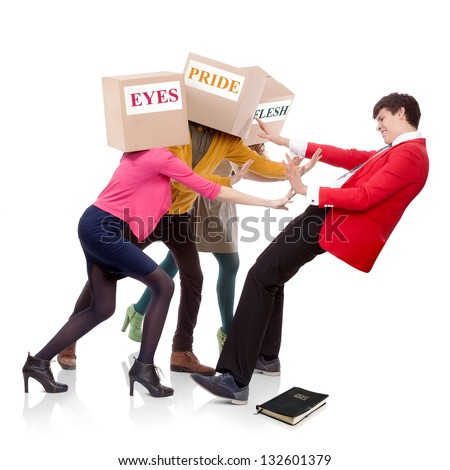 Three people with boxes in the head that push a young man to fall down. Spiritual concept. - stock photo