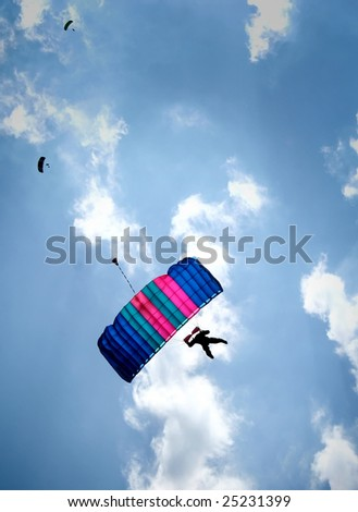 Three people with parachute
