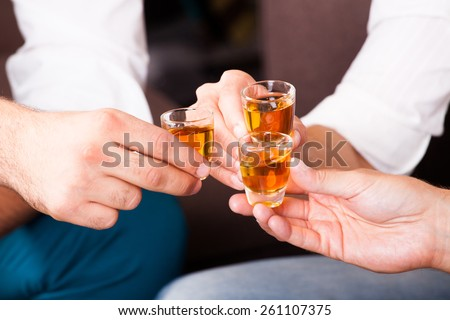 three people with rum shots - stock photo