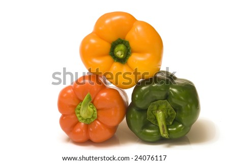 three peppers, red, green and orange in a pyramid on a white background