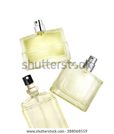 Three perfume bottles floating on white background. Clipping path - stock photo