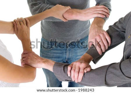Three person business team with hands and arms linked in unity and support. - stock photo