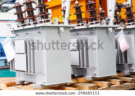 Three phase corrugated fin hermetically sealed type oil immersed transformer in production Line - stock photo