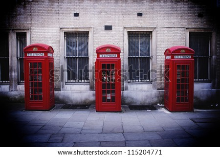 Three phone boxes, London - stock photo