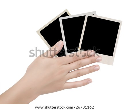 three photo frames in a hand over white