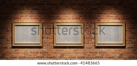 Three pictures on a brick wall - stock photo